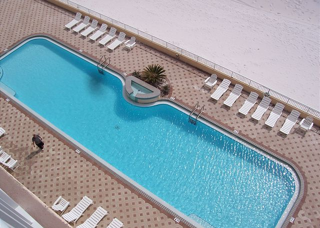 Our 80 foot heated swimming pool is beachside! The deck has ample space for basking in the warm Florida sun. (NOT A VIEW FROM THE UNIT)