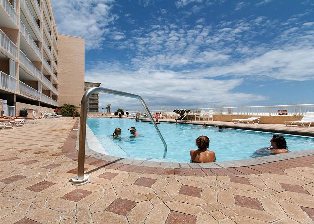 Our 80 foot heated swimming pool is beachside! The deck also holds a hot tub and ample space for basking in the warm Florida sun. (NOT A VIEW FROM THE UNIT)