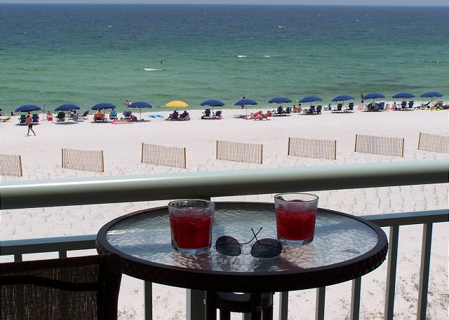 The balcony directly faces the Gulf and the complimentary beach service below.