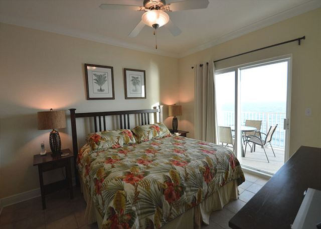 Bedroom 1.  Access to balcony.