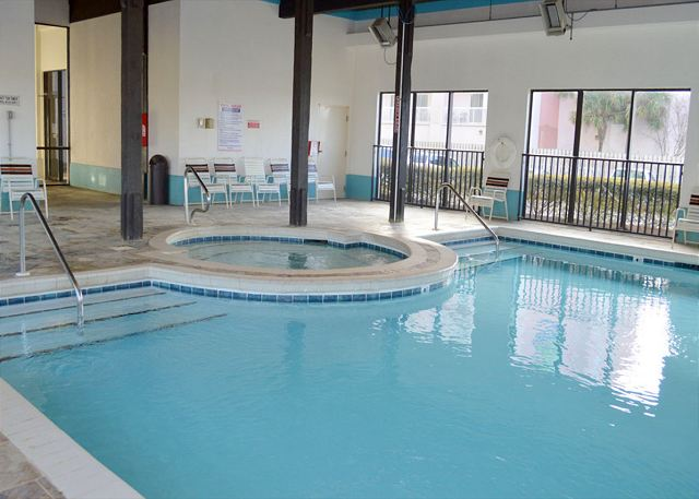 Indoor pool with child's pool.