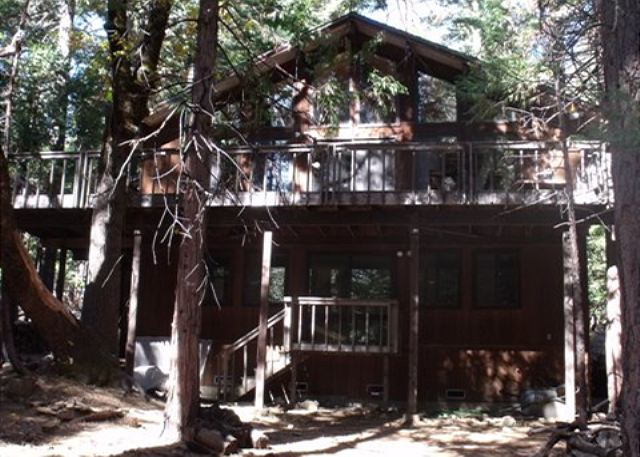 This family cabin offers lots of windows,  a large deck on the main floor and patio doors off the downstairs game room also.