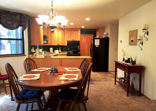 Looking into the dining area to the open Kitchen.