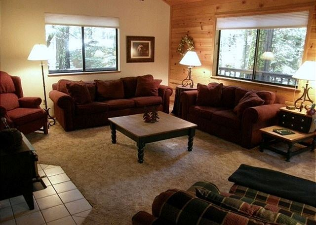 Very comfortable living room with a wood stove to warm you on those blissful winter nights.