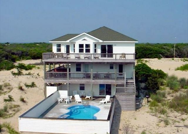Footprints in the Sand.  Nice pool and oceanfront decks.  INSIDE has NEW carpets and furnishings.