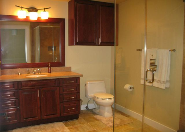 This oversized full bath serves the third bedroom and guests.