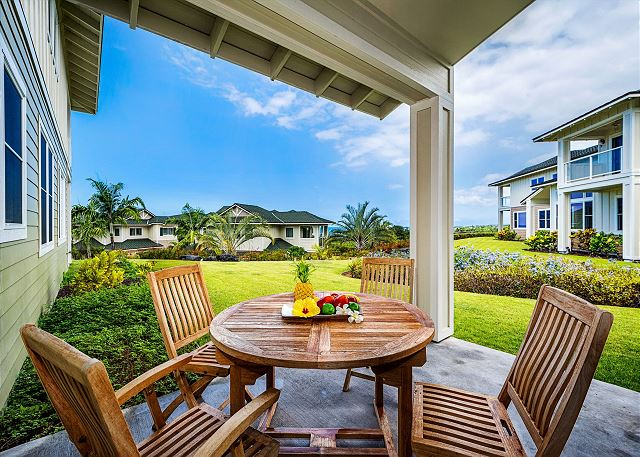 The downstairs lanai features a private garden view and a small view of the Pacific Ocean