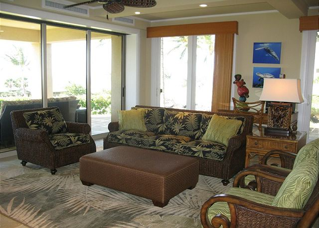 The living area opens to the lanai and the expansive ocean view.