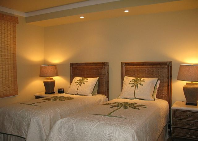 This guest bedroom features two comfortable twin beds that may be converted to a king upon prior request.