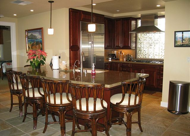 The seating for 6 around the bar offers the opportunity to be close to the action in the upscale kitchen.