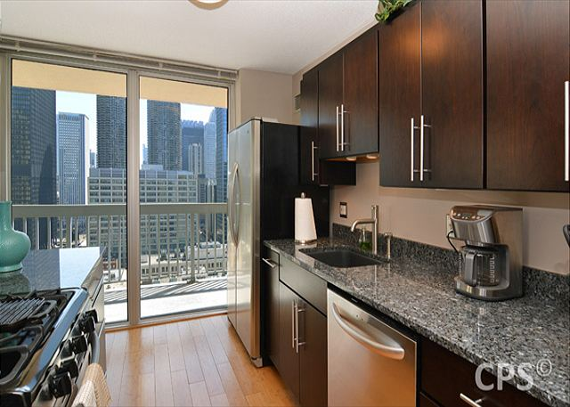Kitchen-Fully stocked and functional, stainless appliances & plenty of cabinets