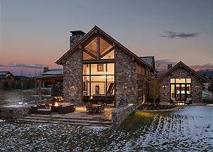 Back Exterior at Night - Four Pines 102 - Teton Village Luxury