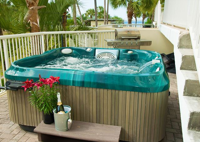 Private Hot Tub with view of the Lazy River
