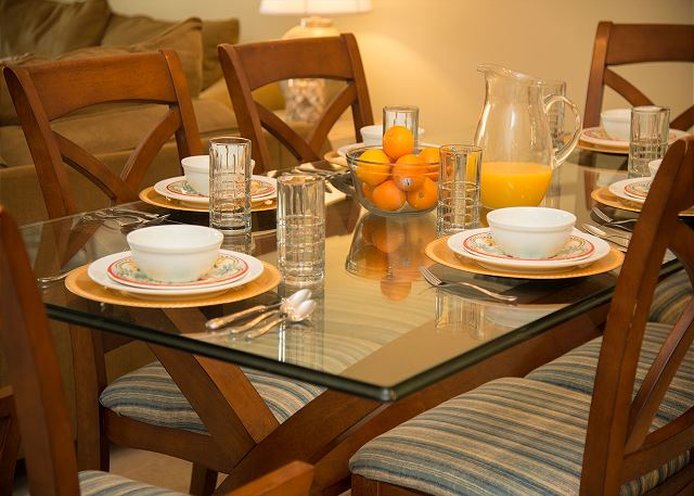 Dining Table with Dishes and Glassware