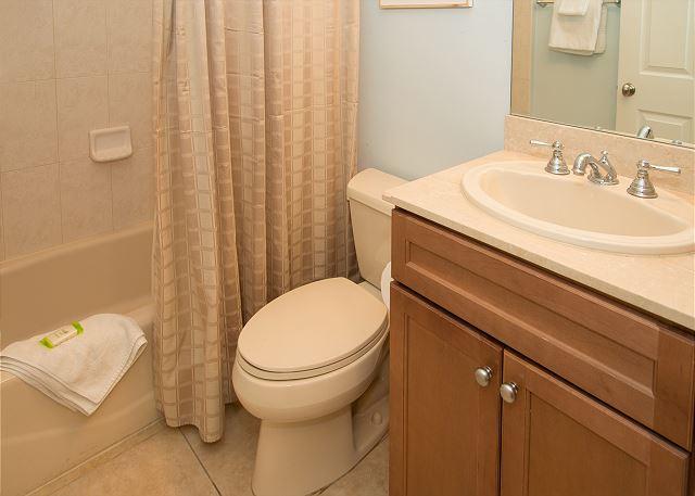 Full Guest Bathroom with Tub off Hallway