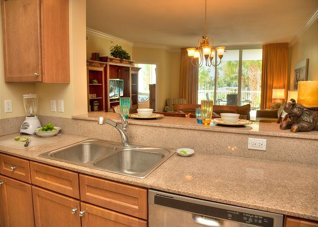 Kitchen Sink and Dishwasher with access to breakfast Bar and Vie