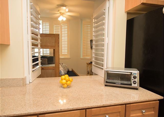 Kitchen Counter with Toaster Over and View into Bunk Room. The s