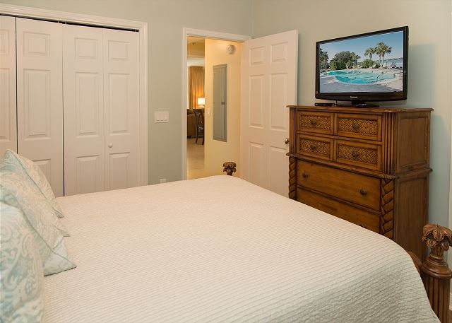 Front Left Guest Bedroom with Queen Bed, Closet and Television