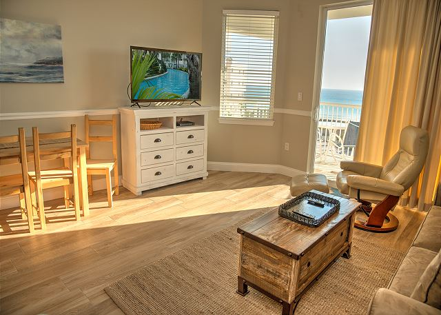 Bright and Sunny Living Room has a large smart TV.
