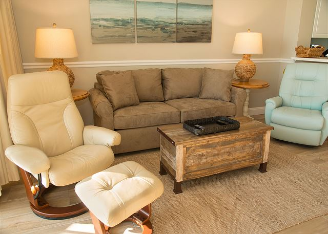 Sit back and relax in one of the two recliners in the living room.