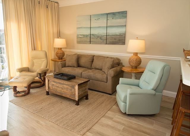 Living Room has a new sofa, two recliners and great views of the beach