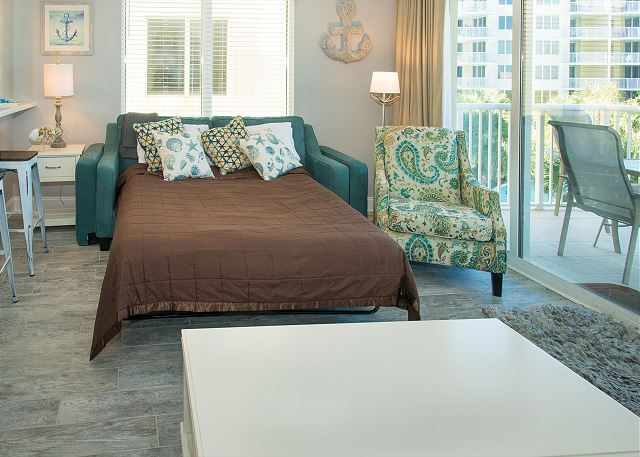 The sleeper sofa has upgraded mattress and the living room has plenty of room even with the sleeper pulled out.