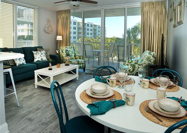 The living room and dining area have great views of the lazy river and views of the bay.