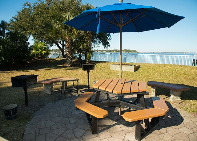 The picnic area located in the open area behind the lazy river is convenient for your grilling needs