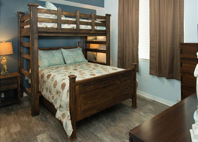 Queen bed with a twin over the bed