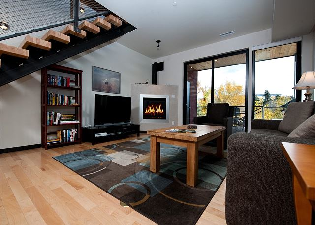 Living room with TV and Deck access.