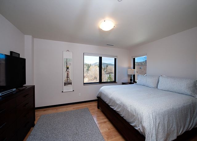 Master bedroom with a king size bed and TV