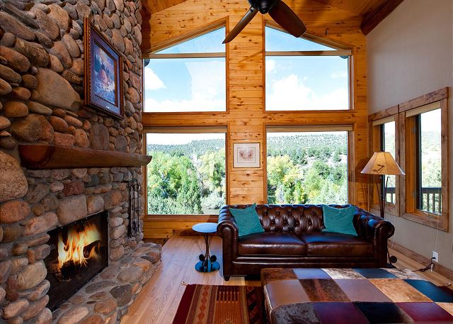 Living room with TV, fireplace, and ceiling fan