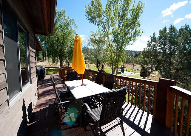 Outdoor patio with seating area and BBQ grill