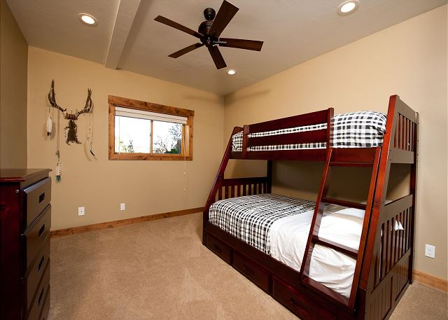 Bedroom with bunk beds (single over double) and ceiling fan