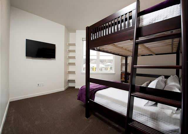 Third bedroom with bunk bed - Queen bed over double bed with TV