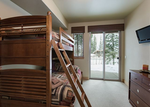 Bedroom with bunk beds (single over double) and TV
