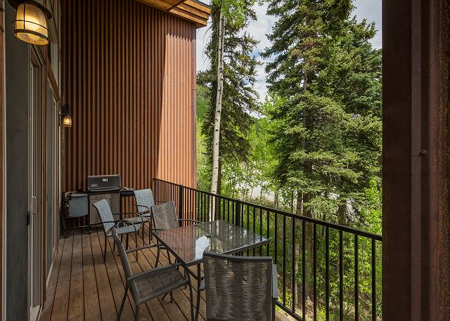 Deck with outdoor grill and lounge furniture