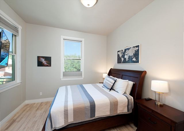 2nd Bedroom - Queen size bed and TV