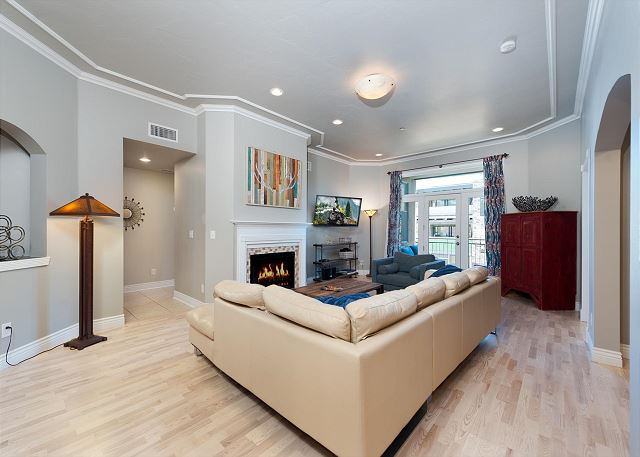 Living room with a deck, fireplace, and TV
