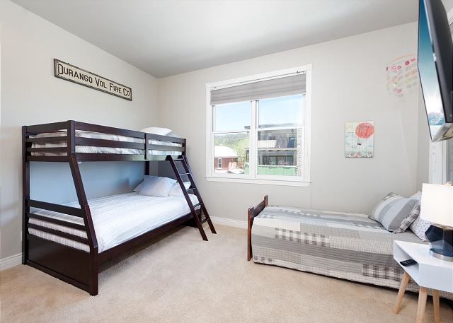 3rd Bedroom - Bunk Beds (Single over Double) and Twin. TV in room.
