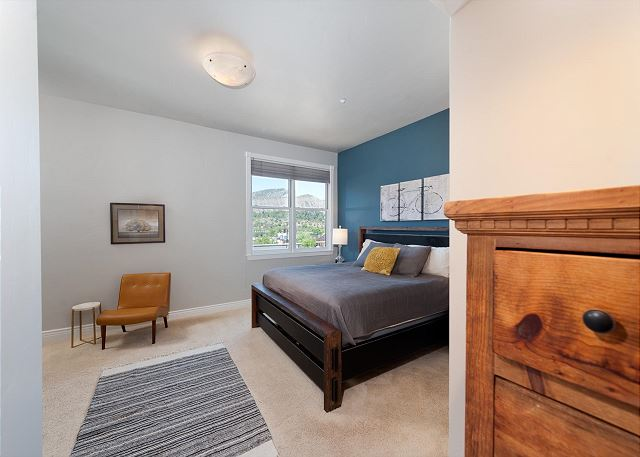 Main bedroom with king size bed and TV