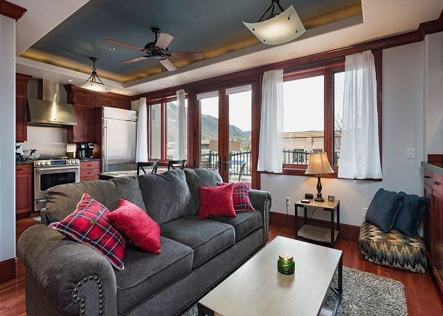 Living room with ceiling fan and TV