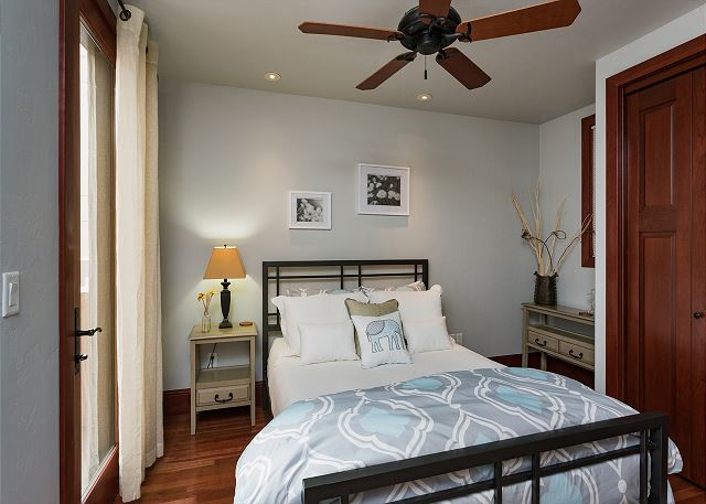 Second bedroom with queen and ceiling fan