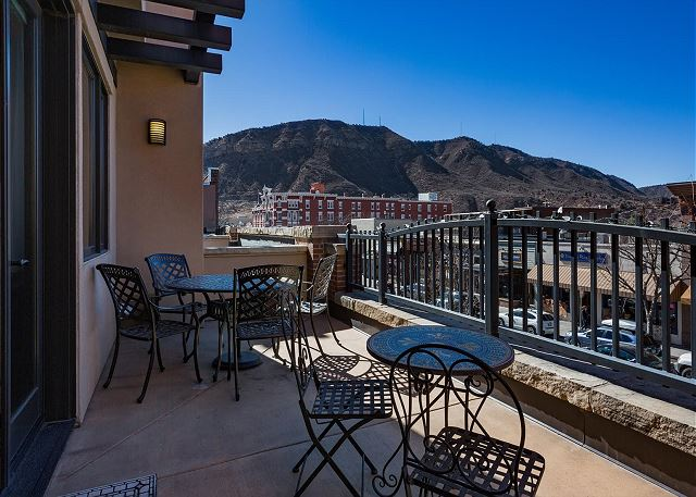 Outdoor patio space with view over Main St. in downtown Durango