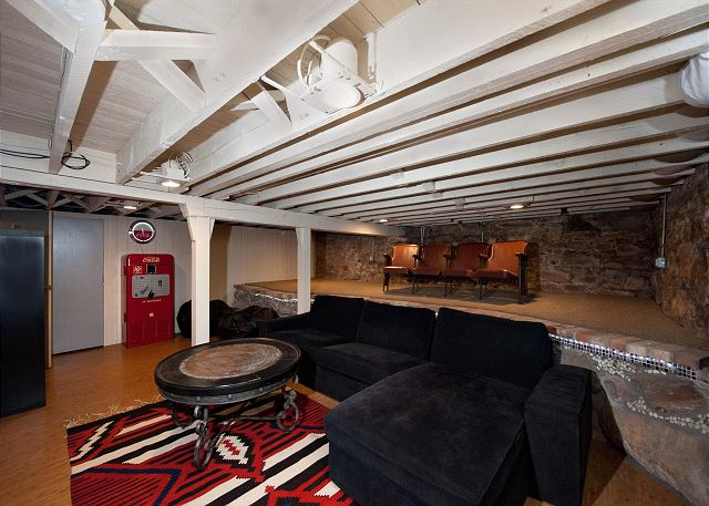 Basement entertainment area with TV