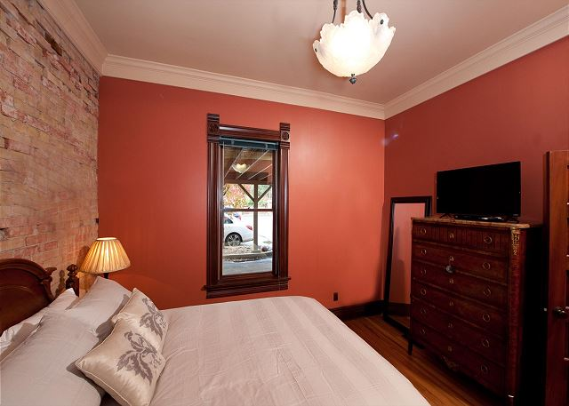 Bedroom with queen size bed and TV