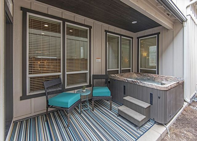 Hot tub with patio area and grill