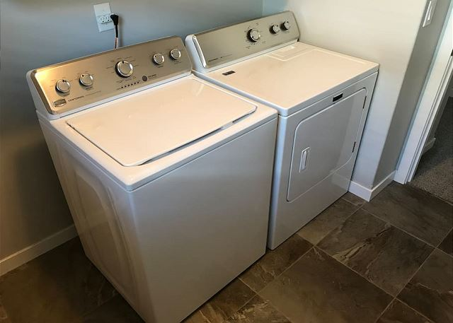 Laundry room with washer dryer.  Located upstairs with bedrooms