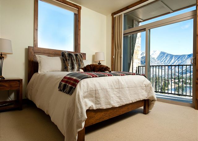Master bedroom with ceiling fan, fireplace, and access to back patio with mountain views  Bed size: Queen