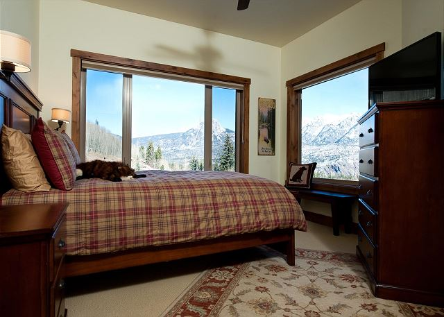 Second bedroom with TV, ceiling fan, and mountain views.   Bed size: Queen